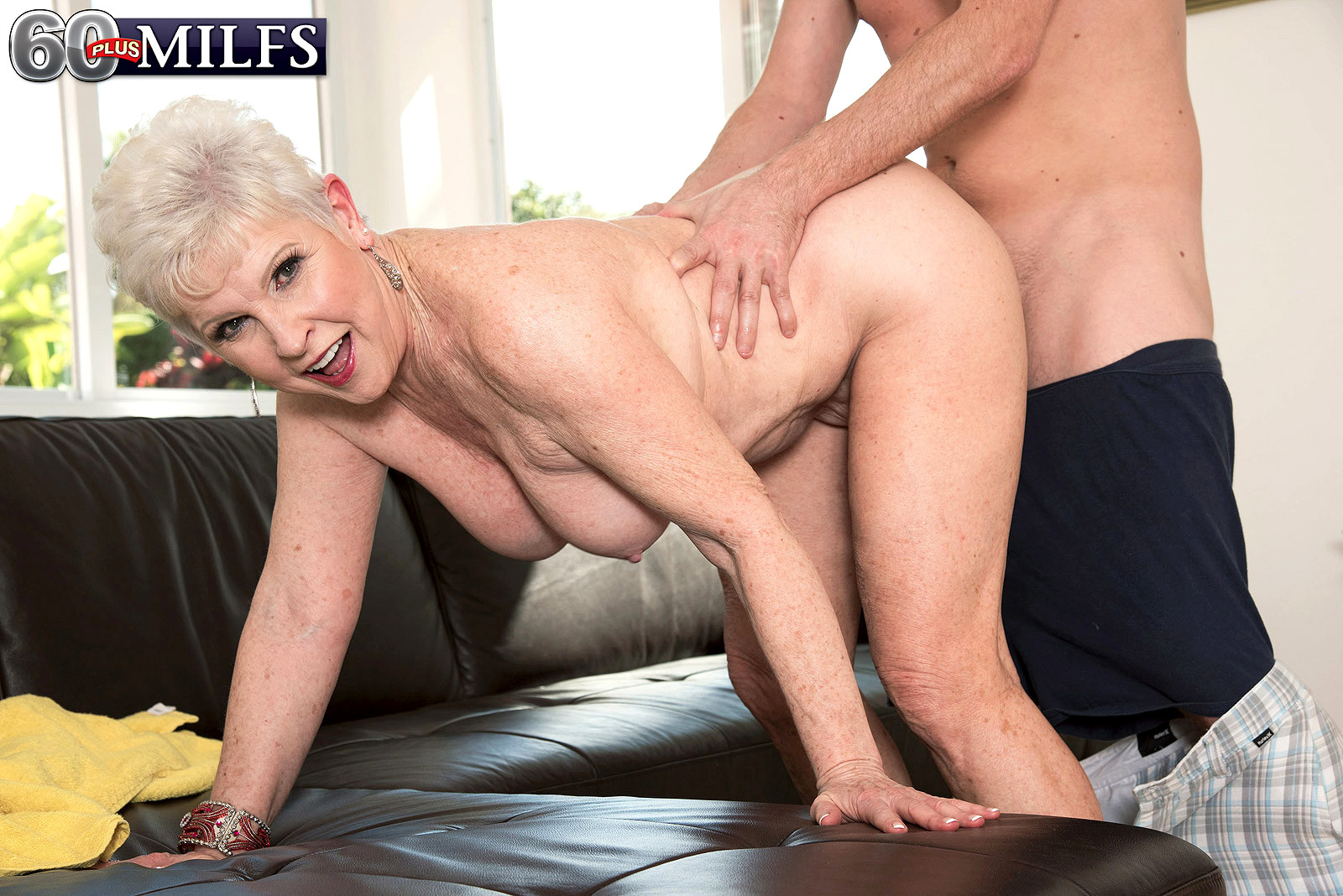 Grandma and a horny young guy having sex